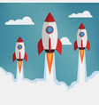 three rockets in the clouds vector image