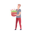 young man holding pot with blooming flowers flat vector image vector image