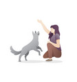 young woman playing with her dog vector image