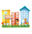 A girl and a boy in the garden with a wooden vector image vector image