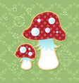 two beautiful poisonous fly agarics on a green vector image