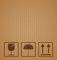 Fragile symbol with brown cardboard texture vector image