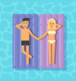 man and woman floating on mattresses in a vector image