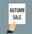 man showing paper autumn sale text vector image