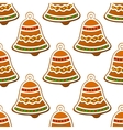 Christmas gingerbread bell seamless background vector image vector image
