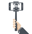 Hand with smartphone on selfie stick vector image vector image