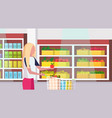 woman housewife carrying full trolley cart of food vector image