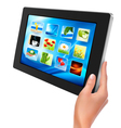 Tablet pc with icons and hand vector image