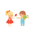 cute little boy with bouquet flowers giving red vector image vector image