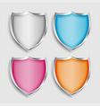 four shiny metallic shield symbols or icons set vector image vector image