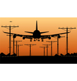 airliner landing at sunset vector image