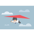 Businessman riding a hang glider vector image