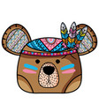 cute bear head animal with feathers vector image