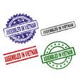 grunge textured assembled in vietnam stamp seals vector image