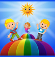 happy kids standing over the rainbow vector image vector image