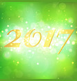 happy new year 2017 on green bokeh abstract vector image vector image