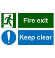Green emergency exit sign on white vector image
