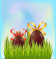 chocolate easter eggs hidden in green grass on vector image vector image