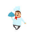 professional restaurant chef holding dish in hand vector image vector image