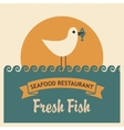 seagull with a fish in its beak vector image