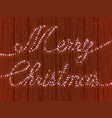 merry christmas a wooden wall with a garland vector image