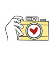 hand holding camera vector image vector image