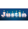 JUSTIN written with burning candles vector image vector image