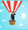 businessman flying in a hot air balloon in search vector image vector image
