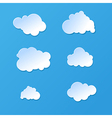 cute cartoon paper or plastic cloud shapes on blue vector image vector image
