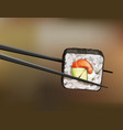 chopsticks holding sushi roll with salmon vector image vector image