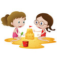 two girls playing sandcastle on beach vector image