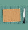 wooden kitchen cutting board with a knife vector image