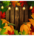 autumn leaves frame and pumpkins on wooden texture vector image vector image
