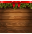 christmas tree red bow on wood background vector image vector image