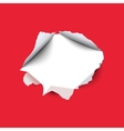 Torn hole in the sheet of red paper vector image