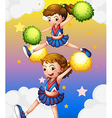 Two cheerdancers with their pompoms vector image vector image