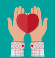 hands giving red heart vector image