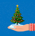 christmas tree decorated in hand vector image vector image
