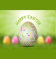 easter egg on defocussed background vector image vector image