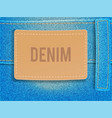 leather label on light blue denim fabric vector image vector image
