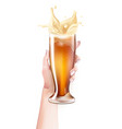 realistic beer glass splashing in hand vector image vector image