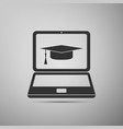 graduation cap and laptop icon isolated vector image vector image