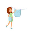 young woman in casual clothing hanging wet clothes vector image vector image