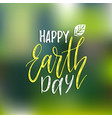 happy earth day hand lettering on blurred vector image vector image