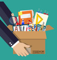 office accessories in cardboard box in hand vector image vector image