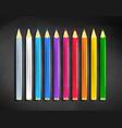 color pencils lying on black chalkboard vector image vector image