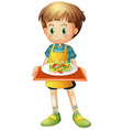 A young boy holding a tray with a plate vector image