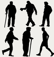 silhouettes of men walking vector image
