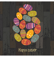 Easter eggs composed on wooden background
