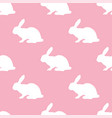 seamless pattern with silhouette of bunny on pink vector image vector image